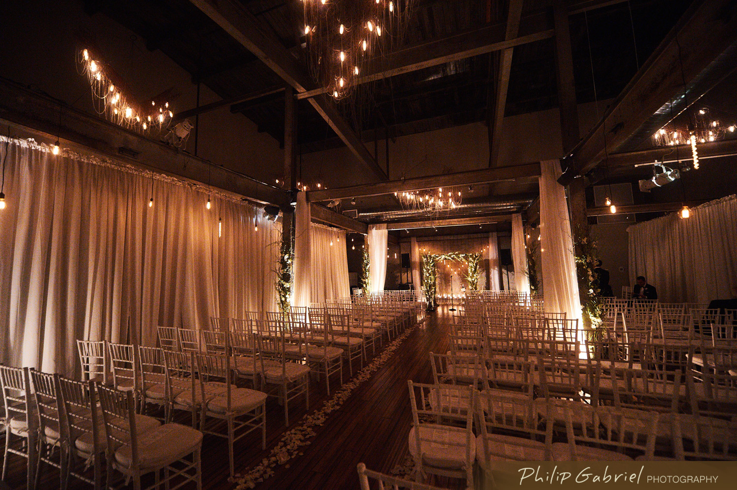 Edison String Lighting Which We Hung In A V Shape Against The Wall To Softly Illuminate Front Of During Exchanging Their Vows